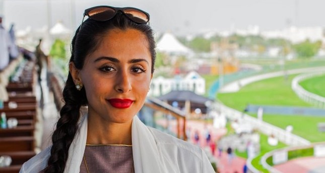 Female Qatari jockey Maryam Al-Subaiey poses for a picture during an interview.