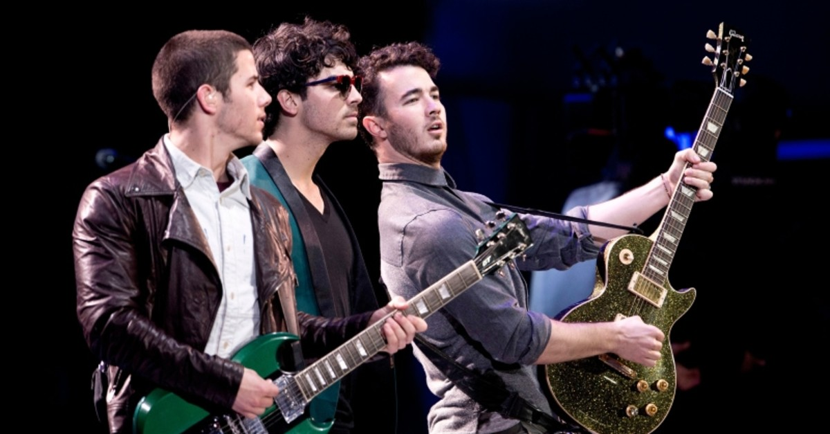 In this file photo taken on February 26, 2013 members of US band Jonas Brothers perform during the 54th Vina del Mar International Song Festival in Vina del Mar, Chile. (AFP Photo)
