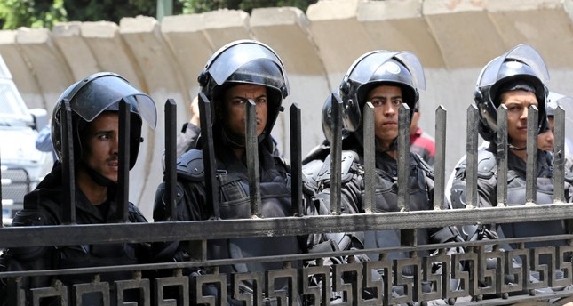 Riot police stand in front of parliament as high school students take part in a protest against the cancellation and postponement of exams after a series of exam leaks, in Cairo, Egypt, June 27.