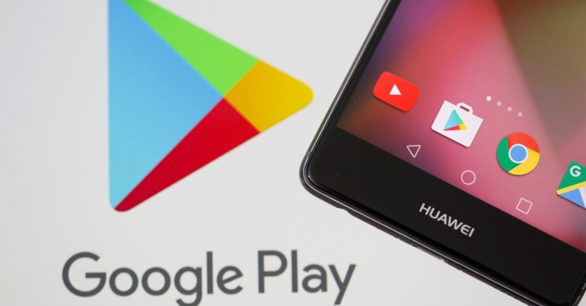 This May 20, 2019 illustration shows a Huawei smartphone in front of displayed Google Play logo. (Reuters Photo)