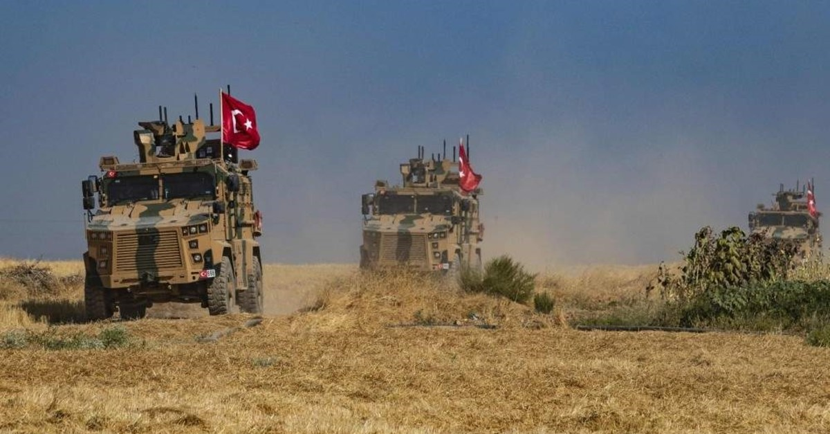 Turkish military vehicles, part of a US military convoy, take part in joint patrol in the Syrian village of al-Hashisha on the outskirts of Tal Abyad town on Oct.4, 2019 (AFP Photo)