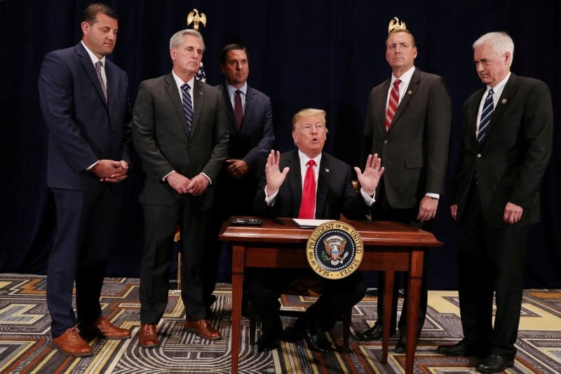 U.S. President Donald Trump speaks prior to signing a presidential memorandum focused on sending more water to farmers in California's Central Valley, at a conference center in Scottsdale, Arizona, U.S., October 19, 2018. (Reuters Photo)