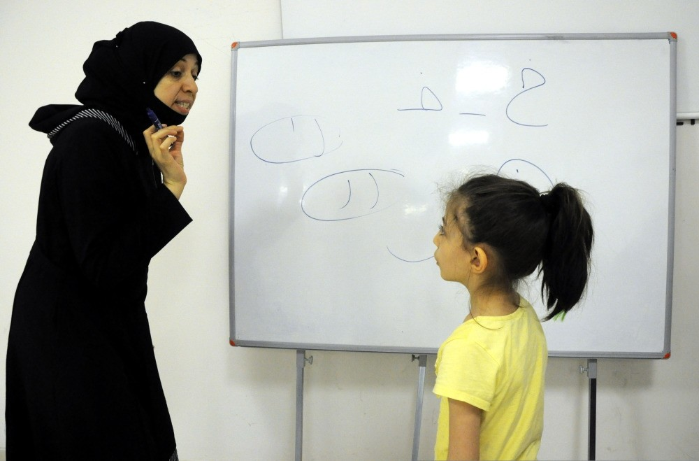 Reema Abdo (L) says learning Arabic will help improve ties between Turks and Syrians.