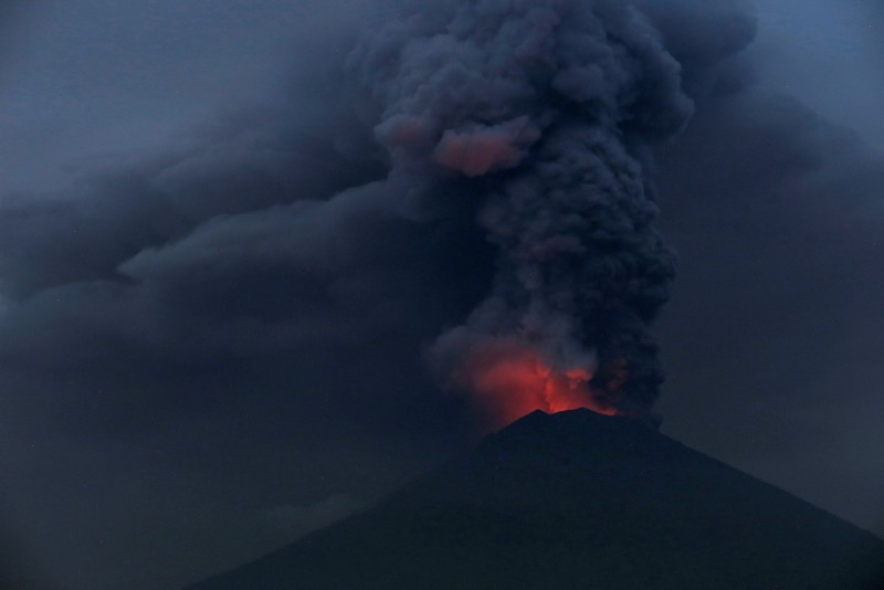 Glowing light of hot lava is seen during the eruption of Mount Agung as seen from Amed in Karangasem, Bali, Indonesia (Reuters File Photo)