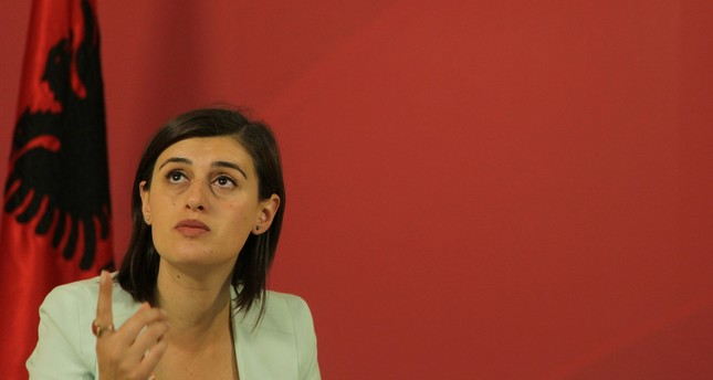 MP and Kosovo 1999 war massacre survivor Saranda Bogujevci, 32, speaks at her party Vetevendosje (Self-Determination) headquarters about what pushed her to get into politics in Pristina, July 28, 2017. (REUTERS Photo)