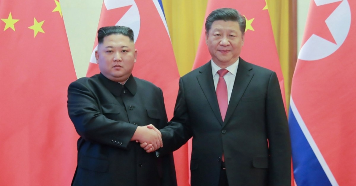 North Korea's visiting leader Kim Jong Un (L) shaking hands with China's President Xi Jinping (R) during a welcome ceremony at the Great Hall of the People in Beijing, January 8, 2019. (AFP Photo)
