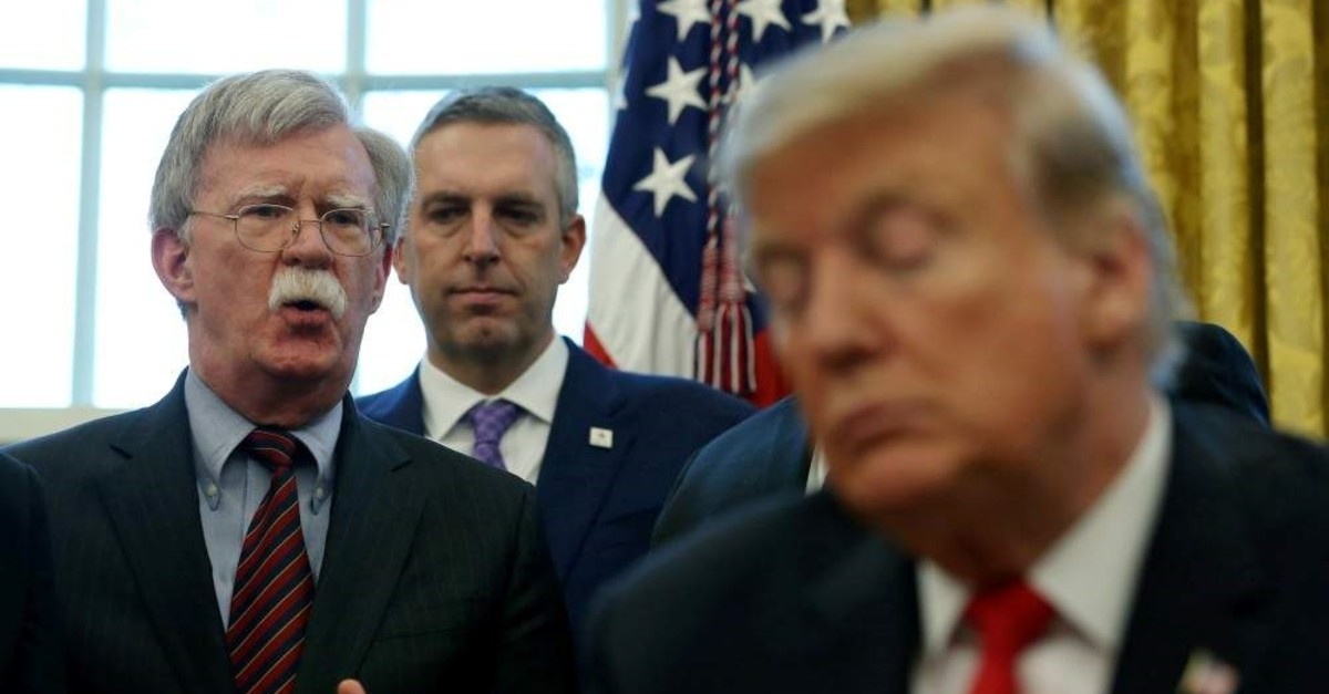 U.S. President Donald Trump listens as his national security adviser John Bolton speaks during a presidential memorandum signing for the ,Women's Global Development and Prosperity, initiative in the Oval Office at the White House in Washington, Feb. 7, 2019. (Reuters Photo)