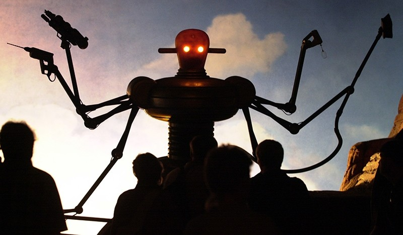 In this Tuesday, Aug. 1, 2000 file photo, visitors of the world exhibition Expo 2000 stand in front of a robot display at the ,Planet of Visions, exhibit at the Expoground in Hanover, northern Germany. (AP Photo)