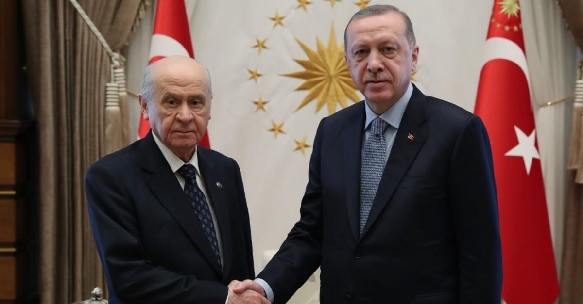President Recep Tayyip Erdou011fan (R) shakes hands with MHP leader Devlet Bahu00e7eli, Feb. 7, 2019.