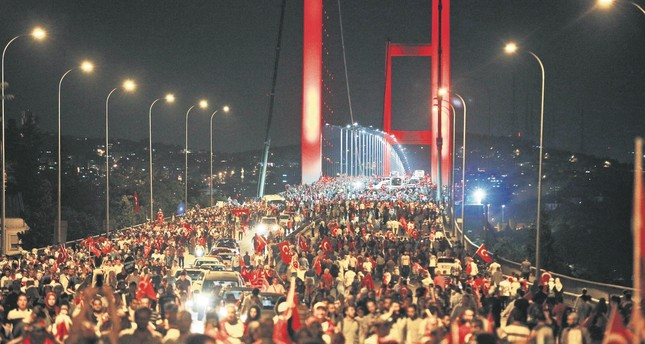 Thousands of people walk over the Bosporus Bridge – now the July 15 Martyrs Bridge – where hundreds of people were killed and injured during the coup attempt.
