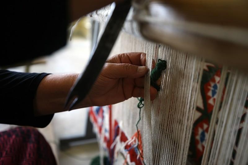 A woman weaves a traditional rug in Bayat, Afyonkarahisar, Turkey. (AA Photo)