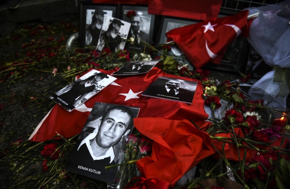 Pictures of victims lie on flowers and flags in front of the Reina nightclub where a Daesh attack killed 39 people during New Year celebrations last year.