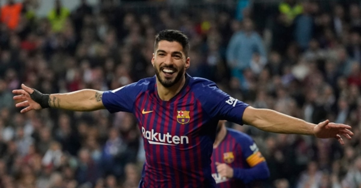 Barcelona forward Luis Suarez celebrates after Real defender Raphael Varane scores an own goal during the Copa del Rey semifinal second leg soccer match between Real Madrid and FC Barcelona at the Bernabeu stadium, Feb. 27, 2019. (AP Photo)