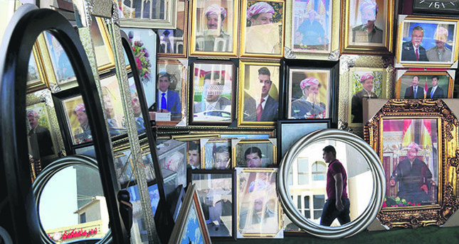 Portraits of KRG leader Masoud Barzani seen hanging in a store in Irbil, the capital of the autonomous Kurdish region of northern Iraq, June 8 (AFP Photo).