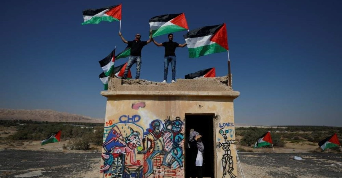 Demonstrators hold Palestinian flags during protests against Jewish settlements in the occupied West Bank, Sept. 28, 2019. (REUTERS Photo)