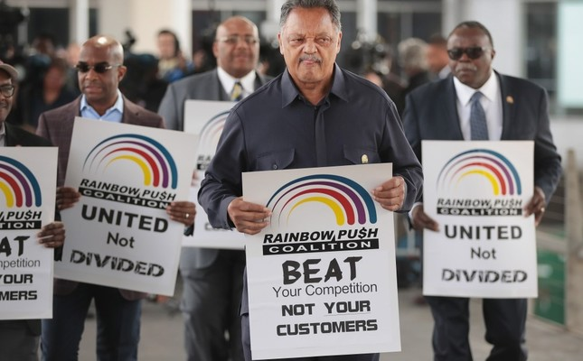 Civil rights leader Reverend Jesse Jackson leads a small group from the Rainbow PUSH Coalition in a protest outside the United Airlines terminal at O'Hare International Airport in Chicago.