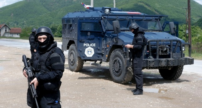 Kosovo police special unit members secure the area near the village of Cabra, north western Kosovo, during an ongoing police operation on Tuesday, May 28, 2019. (AP Photo)