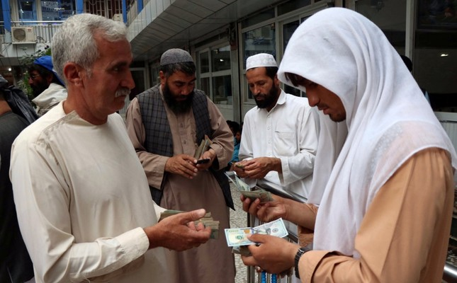 Afghan money changers gather to deal with foreign currency at a money change market in Herat province.
