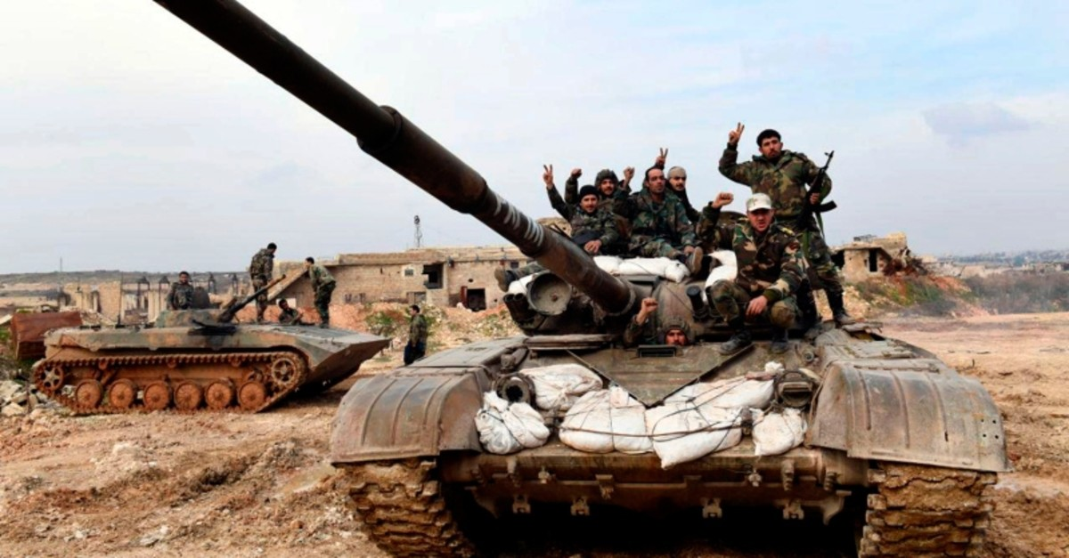 This Monday, Jan. 27, 2020, photo, released by the Syrian official news agency SANA, Syrian regime soldiers flash the victory sign as they stand on their tank in western rural Aleppo, Syria. (SANA via AP)