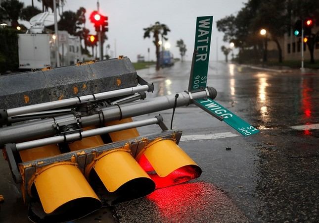 Traffic lights lie on a street after being knocked down, as Hurricane Harvey approaches in Corpus Christi, Texas, U.S. August 25, 2017 (AP Photo)