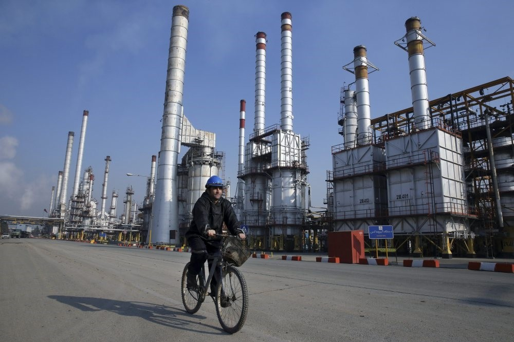 An Iranian oil worker rides his bicycle at the Tehran oil refinery, south of the capital Tehran.