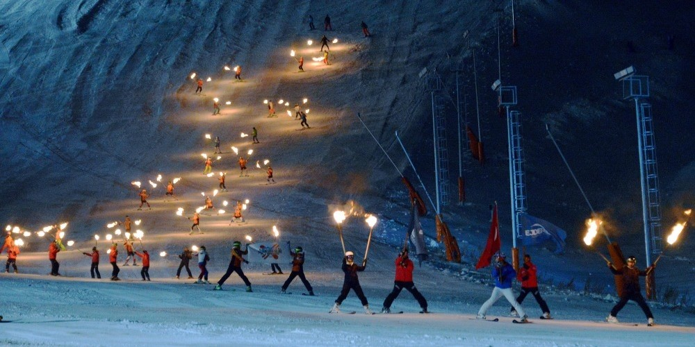 Skiers put on a show with torches in their hands during the season opening of the Palandu00f6ken Ski Resort.