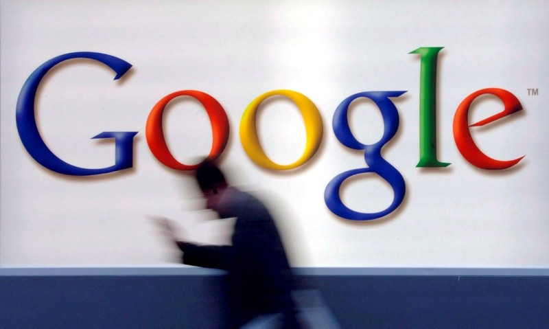 A man passes by a Google logo in Frankfurt, Germany, 21 October 2004 (reissued 02 June 2018). (EPA Photo)