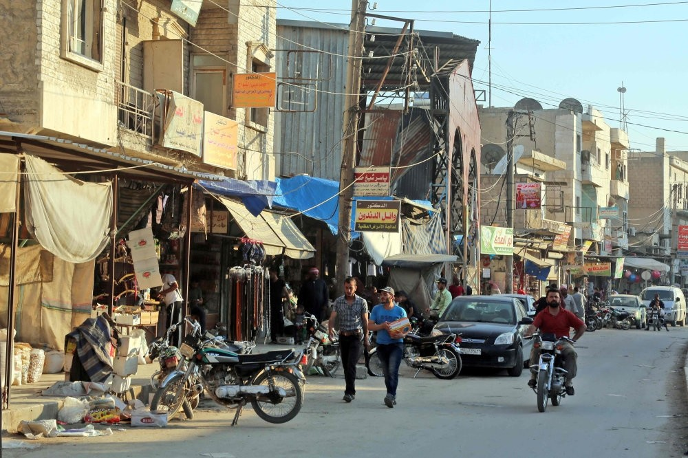 People walk on a street in the northern Syrian province of Manbij, June 6.