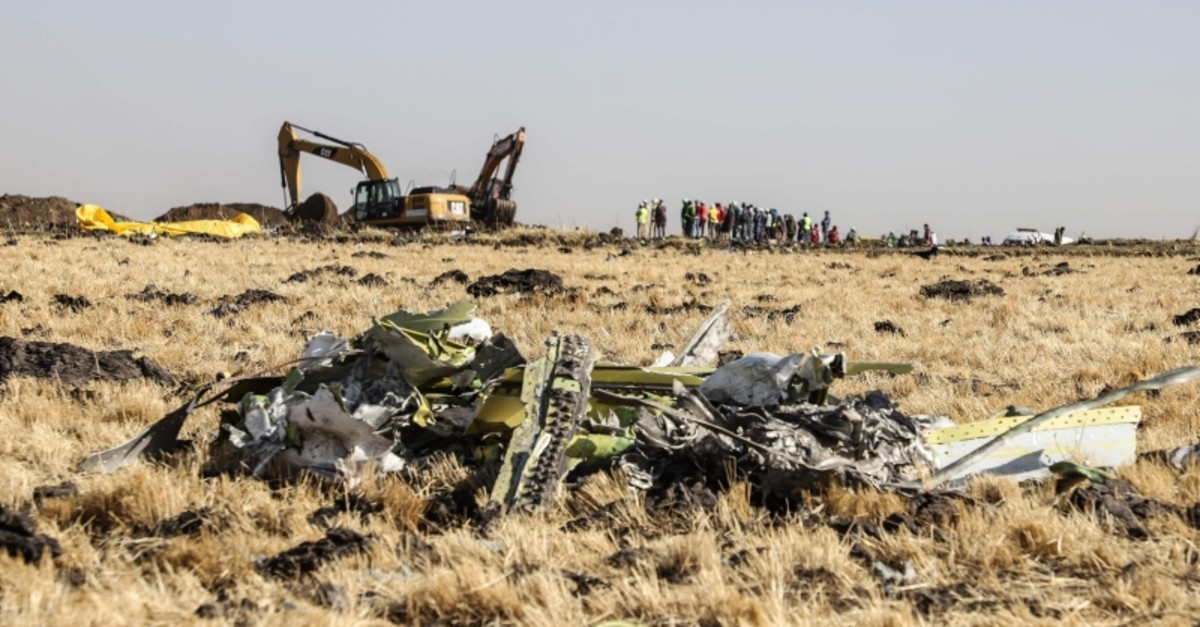 A power shovel digs next to debris at the crash site of Ethiopia Airlines near Bishoftu, a town some 60 kilometres southeast of Addis Ababa, Ethiopia, on March 11, 2019. (AFP Photo)