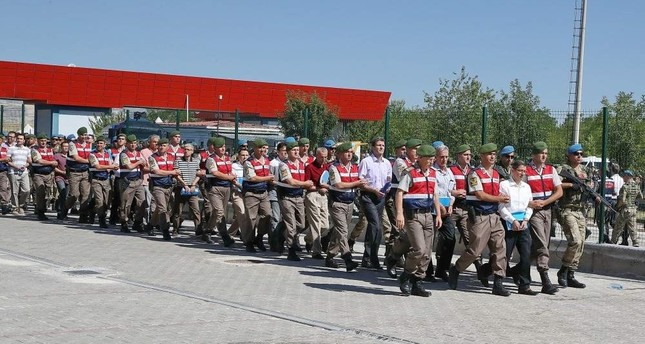 Gendarme officers escort defendants in Ak?nc? trial to the court, Ankara, Aug. 1, 2017. DHA Photo