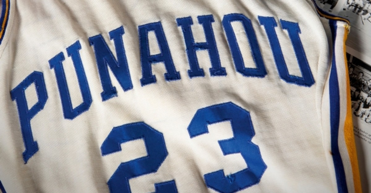 This undated photo released by Heritage Auctions shows a Punahou High School basketball jersey worn by former student Barack Obama. (Heritage Auctions via AP)
