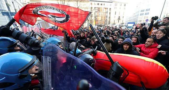 Demonstrators scuffle with police during an anti-fascism demonstration in Milan, Italy, Feb. 24, 2018 (Reuters Photo)