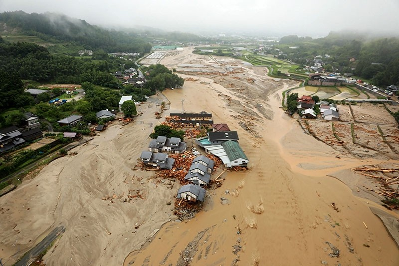The picture shows an areal view of flooded Asakura City, Fukuoka prefecture, on July 6, 2017. (AFP Photo)