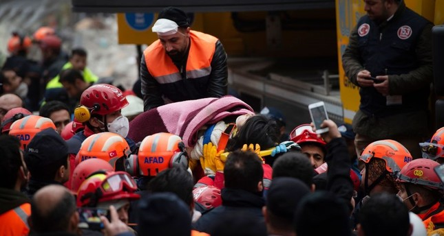 Rescue crews evacuate Havva Tekgöz from the rubble some 19 hours after the collapse in Istanbul's Kartal district on Feb. 7, 2019.