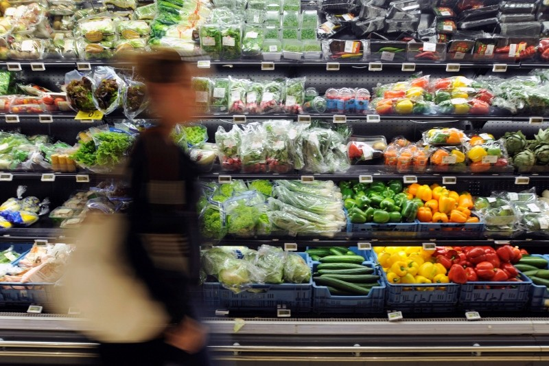 A customer walks past the fruit and vegetable section of a Carrefour grocery store in Brussels, Belgium in this September 4, 2014 file photo. (Reuters Photo)