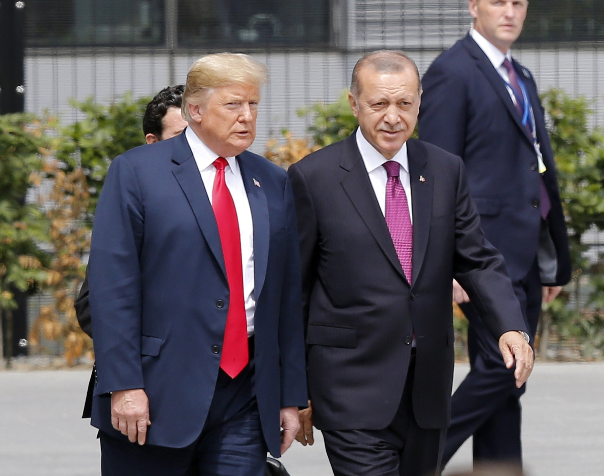 President Recep Tayyip Erdou011fan and U.S. President Donald Trump talk at the start of the NATO summit in Brussels, July, 11.