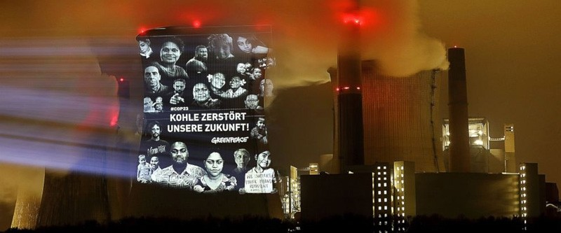 Greenpeace activists project the writing ,Coal destroys our future, on the cooling tower of the lignite power plant Neurath, western Germany, Nov. 10, 2017 during the global climate meeting in nearby Bonn. (AP Photo)