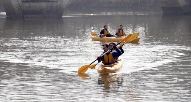 Environmentalists clean plastic waste from Tundzha River in canoes