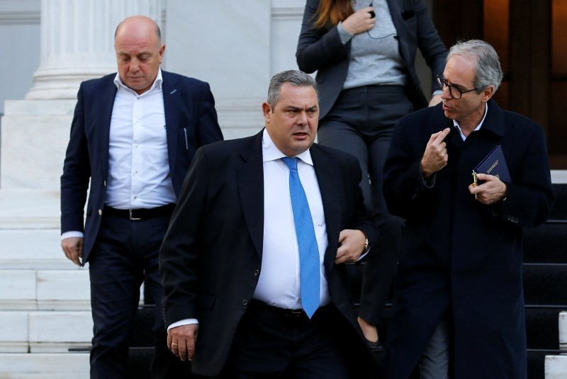 Greek Defense Minister and coalition partner Panos Kammenos exits the Maximos Mansion following a meeting with Greek Prime Minister Alexis Tsipras in Athens, Greece, Jan. 13, 2019. (Reuters Photo)