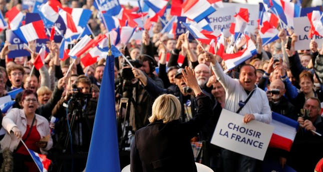 Marine Le Pen, an extremist far-right candidate for the 2017 French presidential election, attending a people's party with supporters in Ennemain, northern France, May 4.