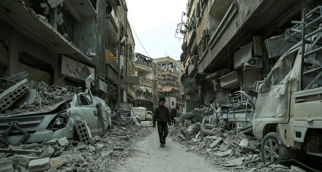 A Syrian child walks down a street in the opposition-held town of Douma, Eastern Ghouta, March 8.