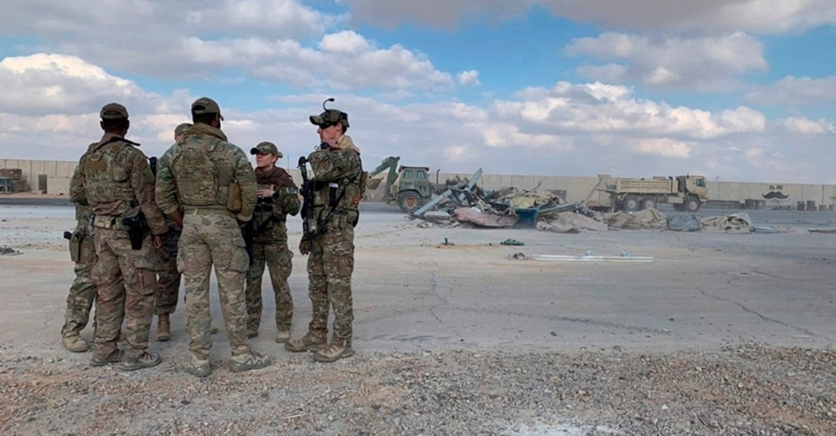U.S. soldiers stand while bulldozers clear rubble and debris at Ain al-Asad air base in Anbar, Iraq, Monday, Jan. 13, 2020. (AP File Photo)