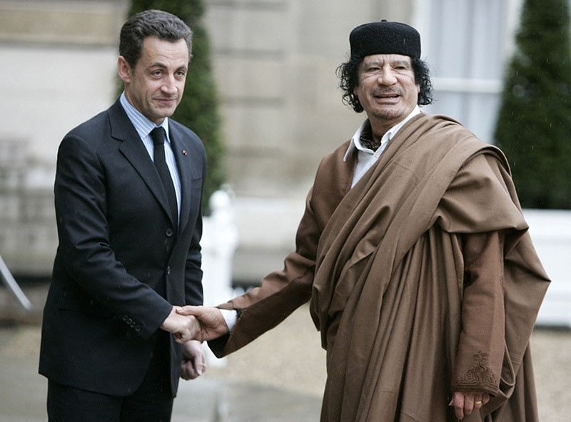 In this Dec. 10 2007 file photo, French President Nicolas Sarkozy, left, greets Libyan leader Col. Moammar Gadhafi upon his arrival at the Elysee Palace, in Paris. (AP Photo)
