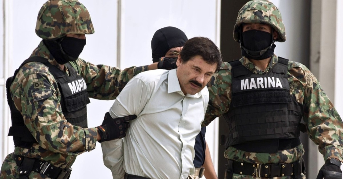 In this file photo taken on February 22, 2014 Mexican drug trafficker Joaquin Guzman Loera aka ,el Chapo Guzman, (C), is escorted by marines as he is presented to the press in Mexico City. (AFP Photo)