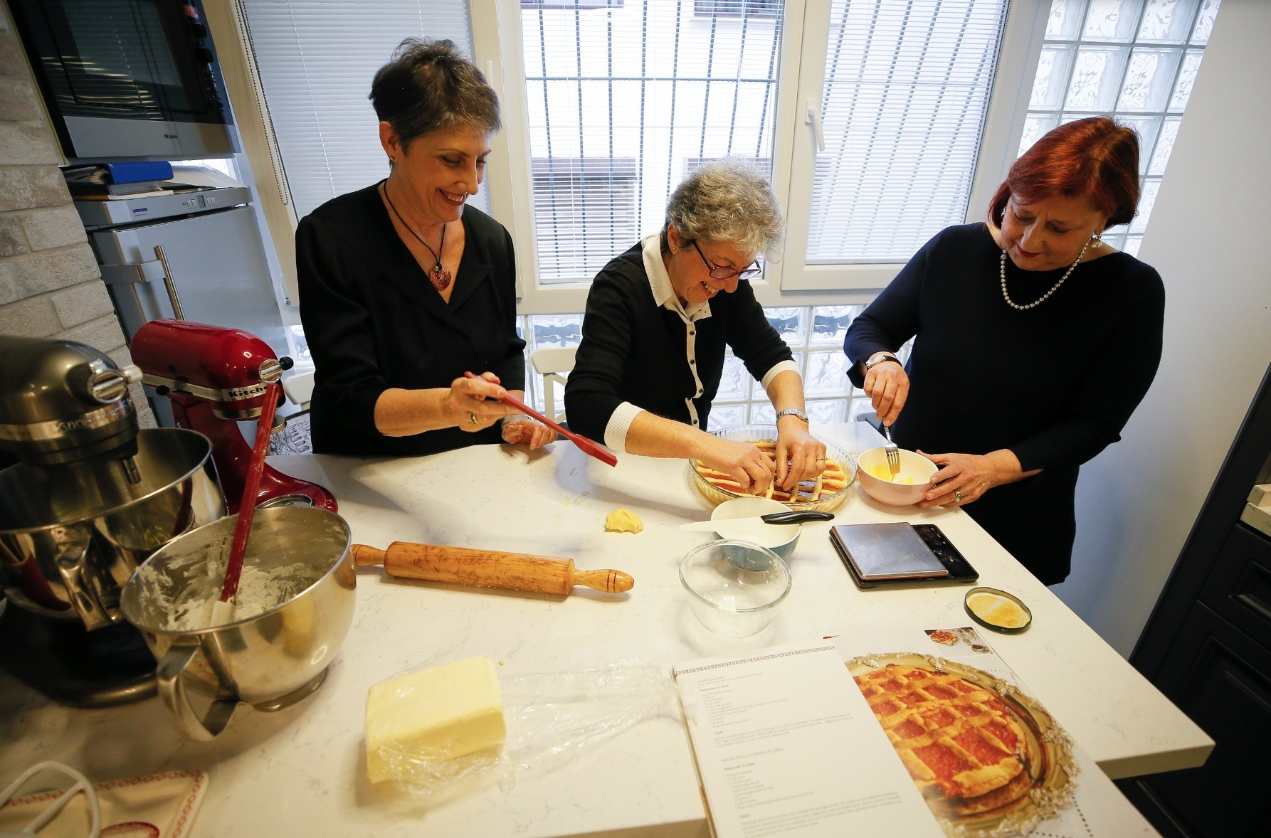 Lotte Filippucci Romano (R) and Ingrid Braggiotti cook one of the recipes from their cookbook u201cTraditional Recipes of the Levantine Cuisine.u201d