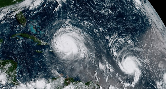 A handout image showing geocolor image from GOES-16 shows Hurricane Irma (L) and Hurricane Jose (R) in the Atlantic Ocean on Sept 7 ,2017. (EPA Photo)