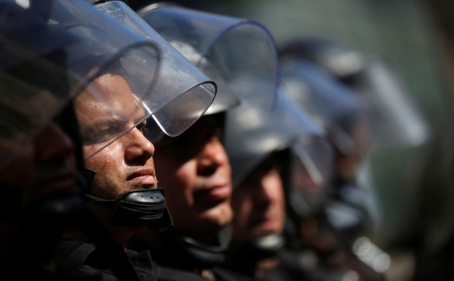Riot police stand guard as members of social groups gather to protest against the Group of 20 summit in Buenos Aires, Argentina, Nov. 28, 2018. (Reuters Photo)