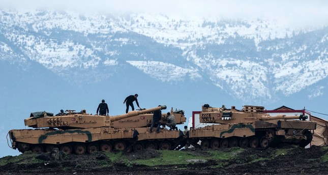 Turkish  soldiers train with tanks and armored  vehicles near the  Syrian-Turkish border in Hatay ahead of Operation Olive Branch, Jan. 24.