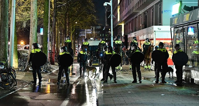 Dutch police move in to assault Turkish protestors in Rotterdam, the Netherlands. (AFP Photo)