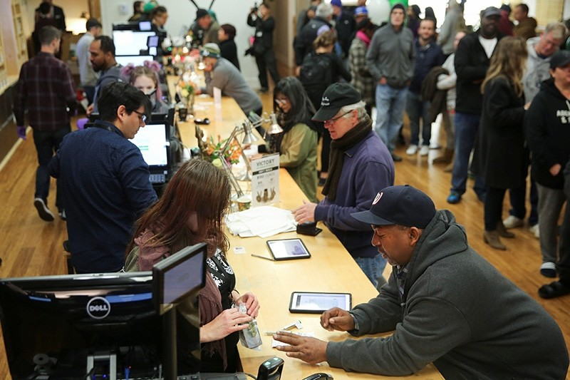Customers purchase marijuana at Harborside, one of California's largest and oldest dispensary dispensaries of medical marijuana, on the first day of legalized recreational marijuana sales in Oakland, California, U.S., January 1, 2018. (Reuters Photo)
